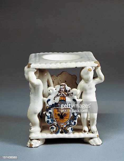 Salt cellar with coat of arms, ceramic, Faenza manufacture, Emilia-Romagna. Italy, 17th century. Milan, Castello Sforzesco, Civiche Raccolte D'Arte...