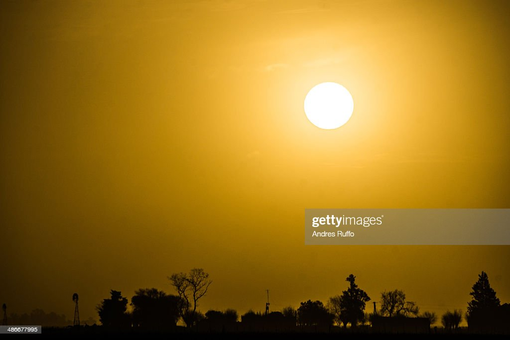 Salt dust clouds along the sun : Stock Photo