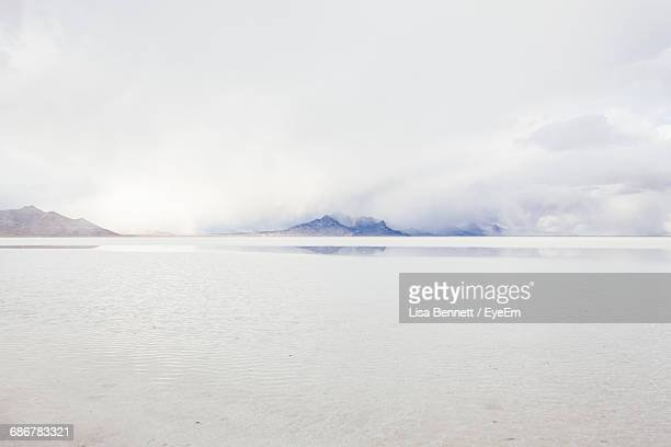 salt flats against sky during foggy weather - salt lake city utah stock photos and pictures