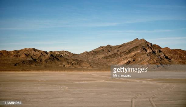 salt flats and dry mountains, bonnaville salt flats, utah, united states - sandy utah stock pictures, royalty-free photos & images
