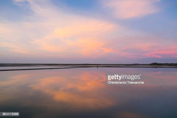 salt flats at ban laem, phetchaburi, thailand - dusk stock pictures, royalty-free photos & images