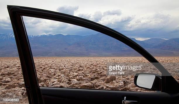 salt flats seen through car door window