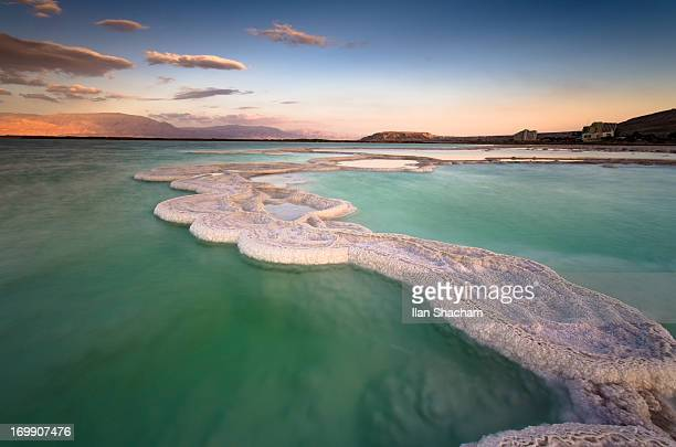 Salt formations and green waters at the Dead Sea