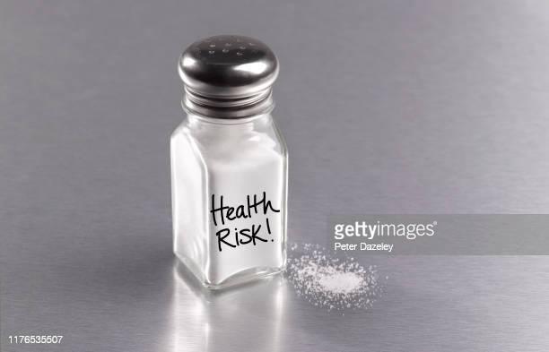 salt in salt cellar with spilt salt, warning health risk - medical condition stock pictures, royalty-free photos & images