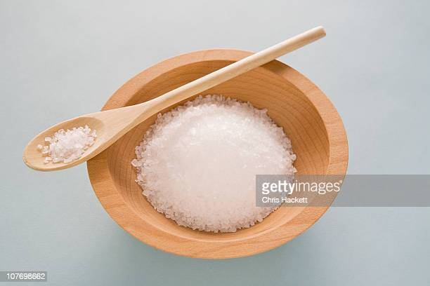 Salt in wooden bowl with spoon