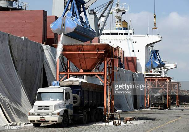Salt is unloaded onto a truck at the Port of Santos in Santos Brazil on Friday July 5 2013 Rising borrowing costs and the global bond selloff...