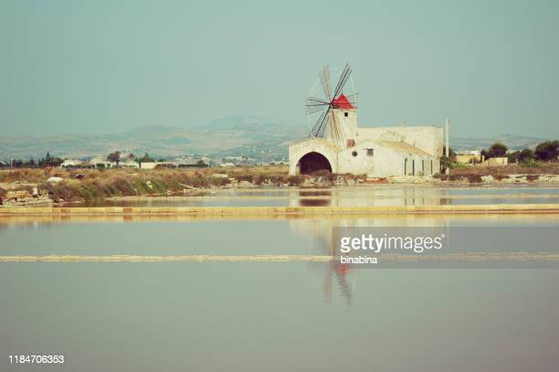"salt lagoon, ""isole dello stagnone di marsala"" nature reserve sicily, italy - marsala sicily stock pictures, royalty-free photos & images"