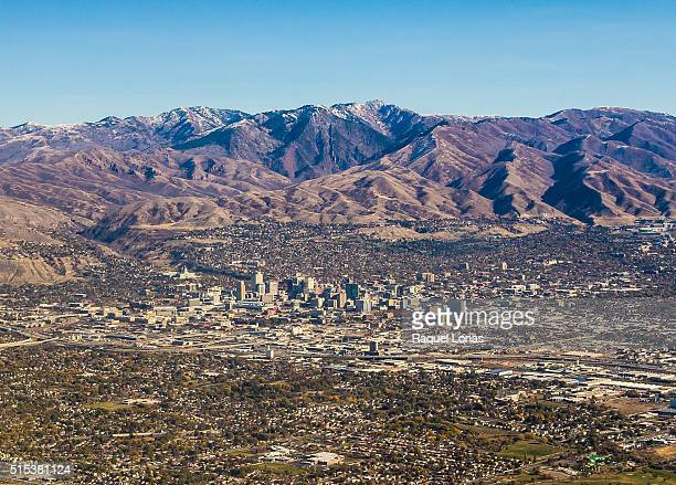salt lake city against the wasatch mountains - salt lake city utah stock pictures, royalty-free photos & images