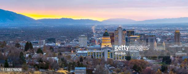 salt lake city at dawn panorama - salt lake city utah stock photos and pictures