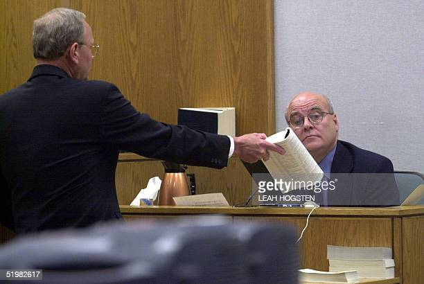 Salt Lake City attorney and defense witness William Morrison gets into a heated discussion with prosecutor Monte Stewart during Tom Green's polygamy...