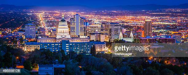 salt lake city downtown landmarks illuminated dusk panorama utah usa - utah stock pictures, royalty-free photos & images