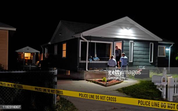 Salt Lake City police investigators go through a house of a person of interest in the MacKenzie Lueck missing person case gathering and removing...