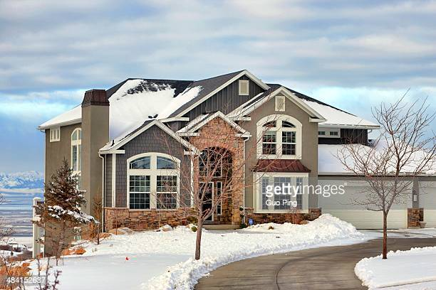 Salt Lake City suburb house on the top of the mountain with snow