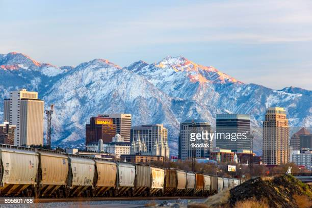salt lake city with first snow in the mountain - park city stock photos and pictures