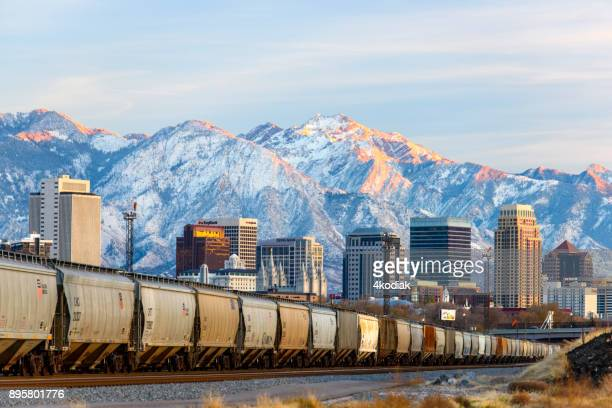 salt lake city with first snow in the mountain - salt lake city utah stock photos and pictures