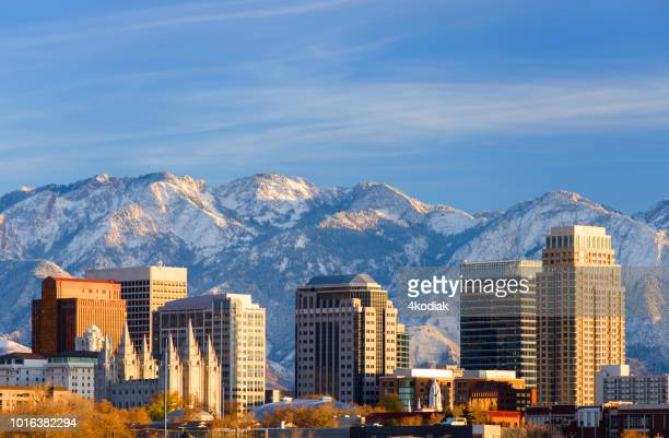 salt lake city with snow capped mountain - salt lake city utah stock photos and pictures