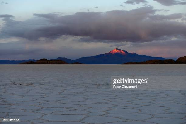 Salt lake with volcano Cerro Tunupa in the last evening light, Salar de Uyuni, Uyuni, Potosi, Bolivia