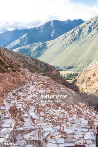 salt mine terraces in peru - ソルトポンド ストックフォトと画像