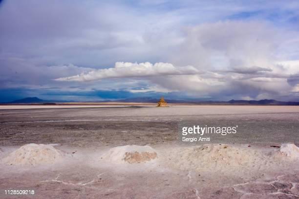 Salt mounds under a dramatic cloudy sky at Uyuni Salt Flats