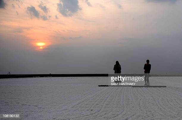 Salt pan worker Sanjuben Melabhai works with her son Mahesh at a salt pan in the Khadaghoda Sector in the Little Rann of Kutch some 160 kms from...