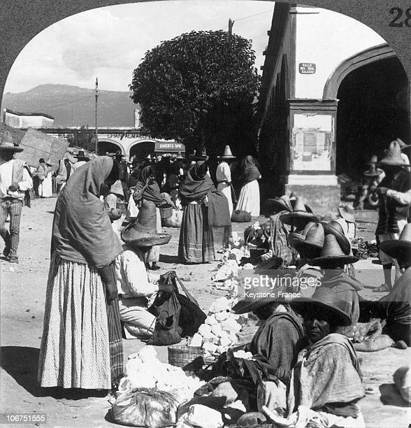 Salt Sellers Seated With Their Merchandise Before Them And Clients Standing Above Them In An Open Air Market In Cuernavaca Mexico Around 19001920