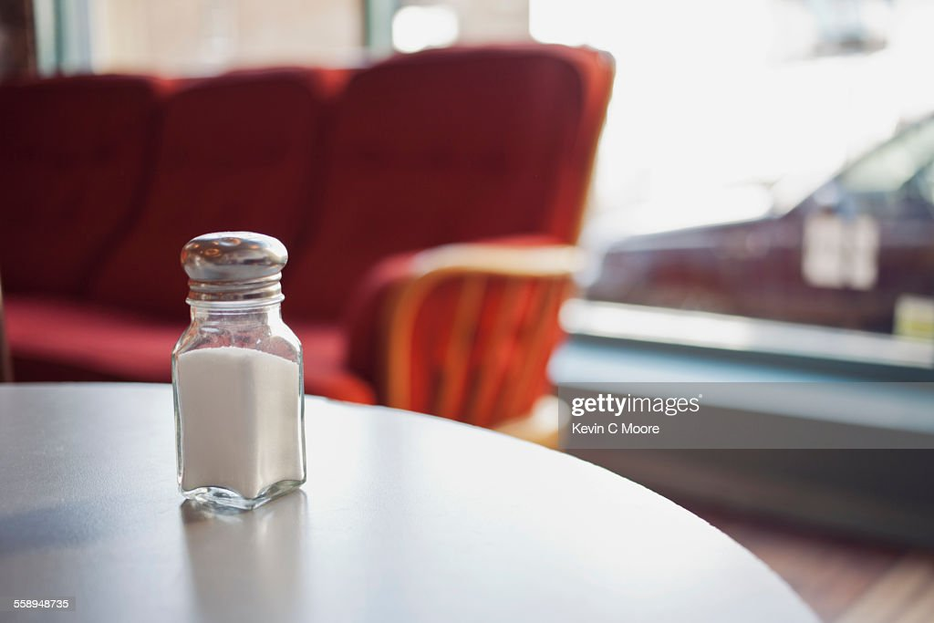 Salt shaker on table : Stock Photo