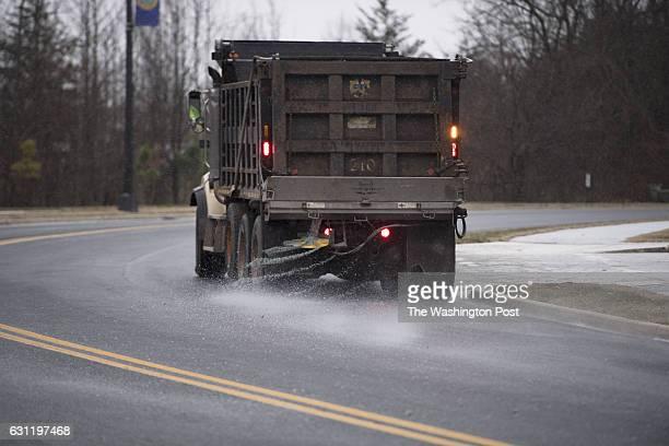 Salt trucks prepare the roads for snow fall in the Washington DC Metropolitan Area on January 2017