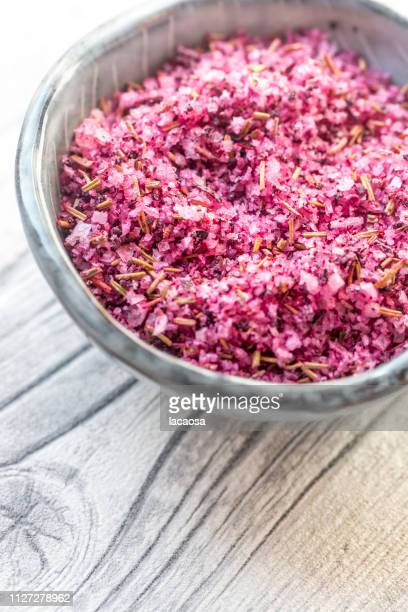 salt with hibiscus blossoms and rosemary
