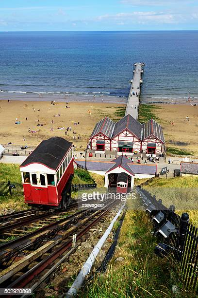 saltburn cliff lift and pier, cleveland - saltburn stock photos and pictures