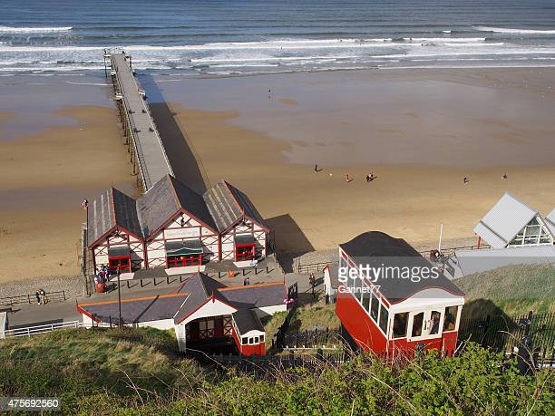 saltburn cliff lift and pier - saltburn stock photos and pictures
