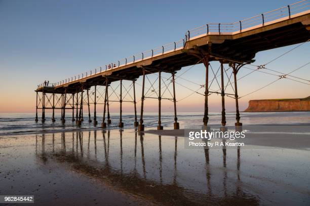 saltburn pier at sunset, north yorkshire, england - saltburn stock photos and pictures