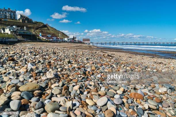 shingle beach, looking to saltburn-by-the-sea, beach, pier, cleveland, north yorkshire - saltburn stock photos and pictures
