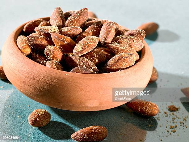 salted almonds in terracotta bowl - salted stock pictures, royalty-free photos & images