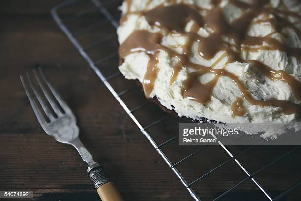 salted caramel cake - rekha garton stock pictures, royalty-free photos & images