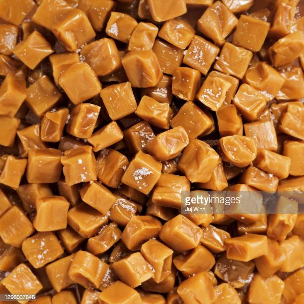 salted caramel candies - caramel stock pictures, royalty-free photos & images