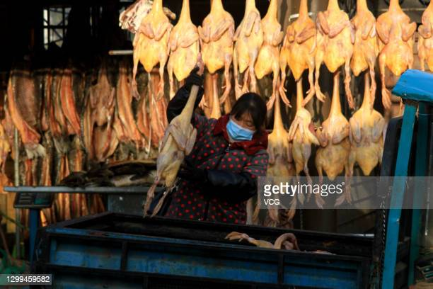 Salted chickens, salted ducks and salted fish are displayed for sale at a market ahead of Chinese New Year, the Year of the Ox, on January 30, 2021...