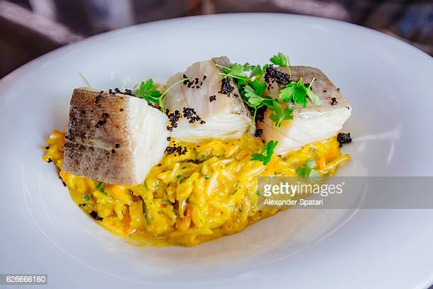 salted cod fish (bacalhau) with rice - portuguese culture stock pictures, royalty-free photos & images