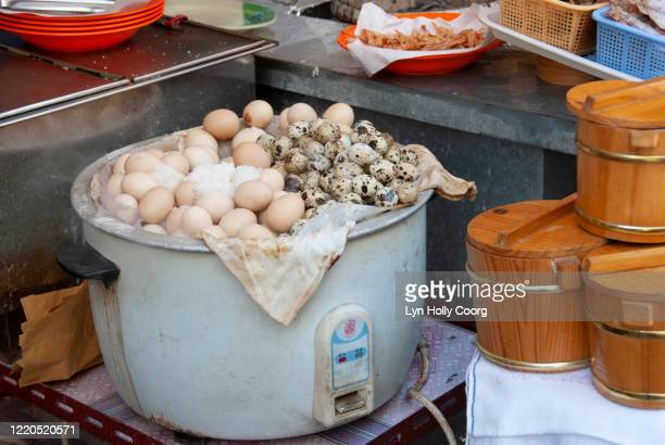salted eggs in cooking pot in hong kong - lyn holly coorg stock-fotos und bilder