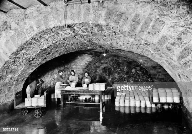 Salting of the cheese in a cellar Roquefort 1925 BOY14485