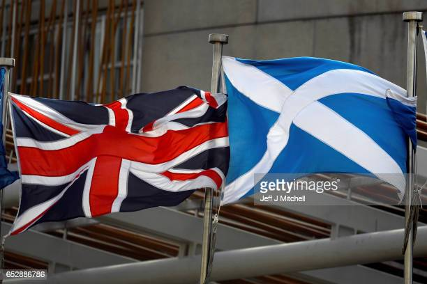Saltire and Union Jack flags flutter in the wind outside the Scottish Parliament on March 13 2017 in Edinburgh Scotland Scotland's First Minister...