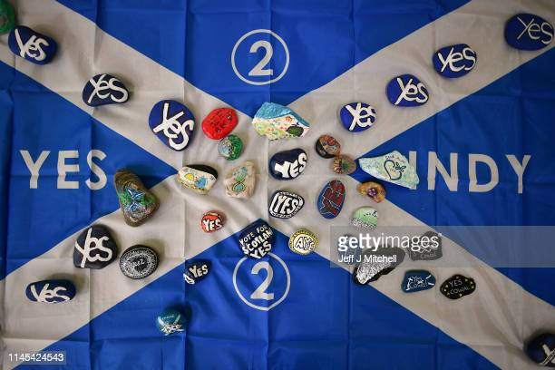 Saltire flag has painted stones placed on it as delegates attend day one of the SNP Spring Conference at the Edinburgh International Conference...