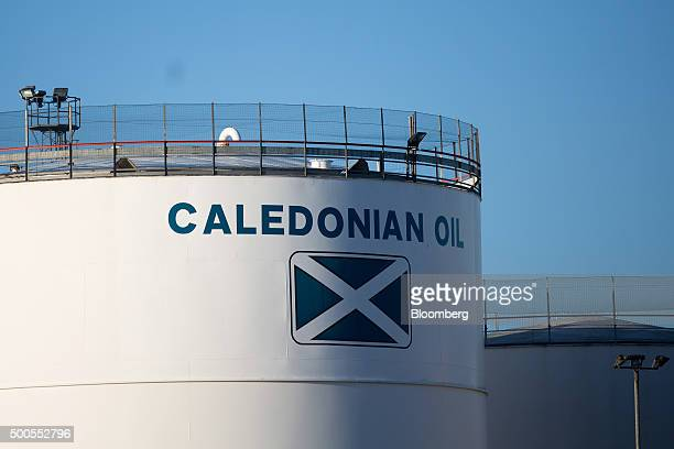 A Saltire flag sign sits on an storage silo operated by Caledonian Oil Ltd at Aberdeen Harbour operated by the Aberdeen Harbour Board in Aberdeen UK...