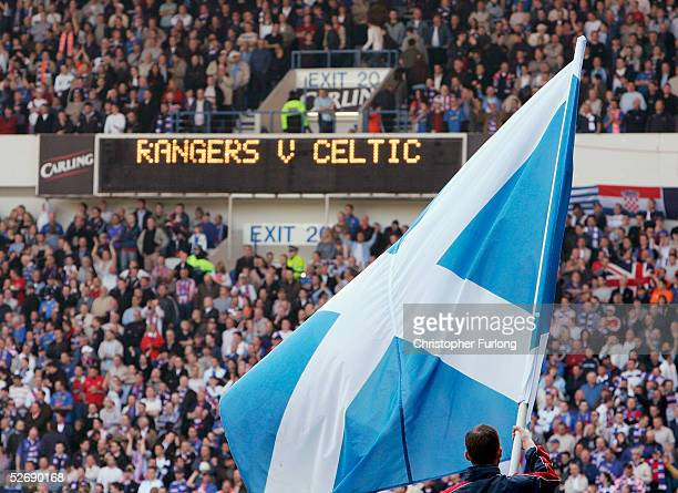 Saltire is raised on the pitch to welcome the teams before the infamous 'Old Firm Game' in the Scottish Premier League match between Glasgow Rangers...