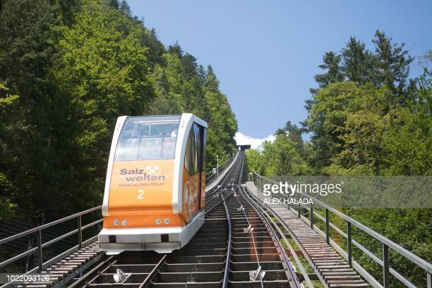 Salt-mountain railway car is pictured at the historic salt mine heritage in Hallstatt, Austria, on August 16, 2018. - Like for all mines, a fresh...