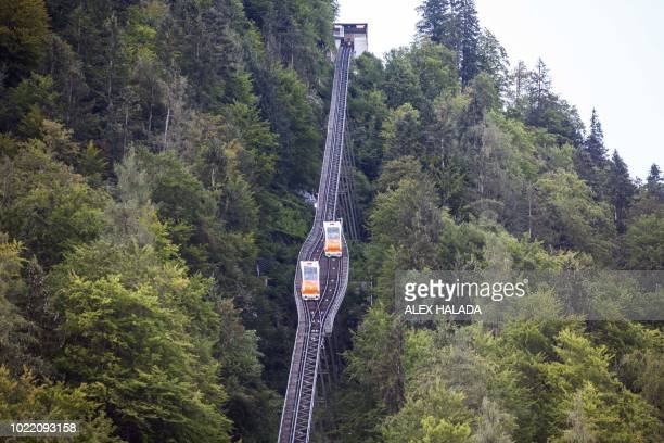 Saltmountain railway cars are pictured at the historic salt mine heritage in Hallstatt Austria on August 16 2018 Like for all mines a fresh round of...