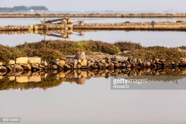 Saltworks canal Saline of Trapani salt nature reserve Stagnone of Marsala Sicily Italy Europe