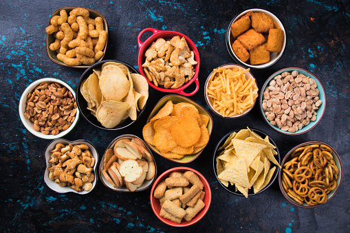 Salty snacks served in bowls 1192712284