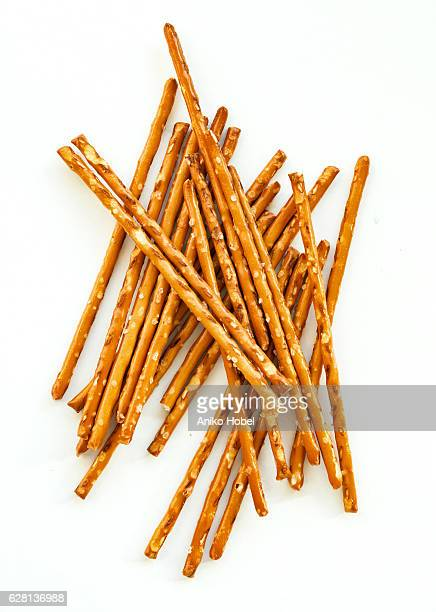 Salty sticks on white background