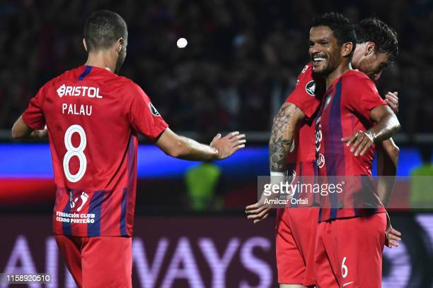 Salustiano Candia and Diego Palau of Cerro celebrate after winning a round of sixteen second leg match between Cerro Porteño and San Lorenzo at...