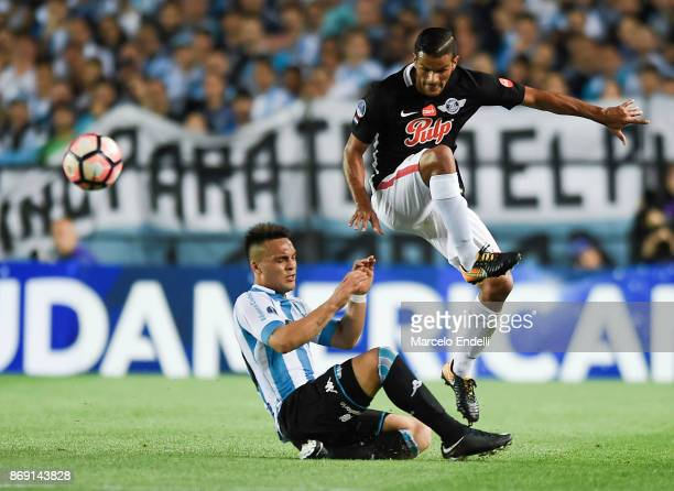 Salustiano Candia of Libertad fights for the ball with Lautaro Martinez of Racing Club during a second leg match between Racing Club and Libertad as...